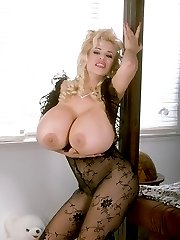 Blonde with Unbelievable Pair of Big Jugs Showing on the Bedside