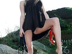 Blonde bimbo shows panty up miniskirt