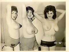 Three retro femmes pack each other with sex toys