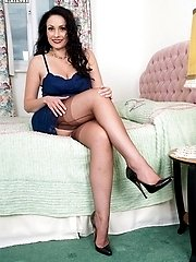 Sophia juggles her full breasts, opening her nyloned thighs...