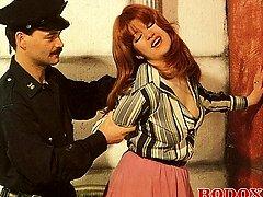 Retro cop pummeling a hooker
