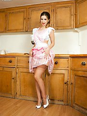 Stella has found the most glamorous pinafore to wear in the kitchen, over her bullet bra, garters and vintage coffee fully fashioned nylons!