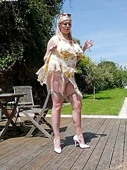 In her frothy frock, sheer full fashion nylons and spiky heels busty Michelle is ready for hot sex.