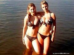 Bikini chicks posing for their pals outdoors