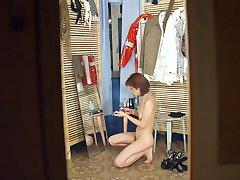 Nude redhead admiring herself in the mirror
