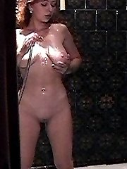 Spy on my horny wife taking a shower