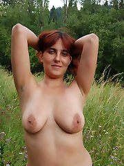 Naked busty milf with desirable body showing off her priceless treasure