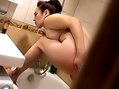 Yummy milf takes a shower under spy cam control
