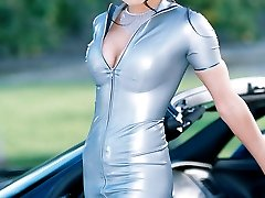 busty babe on Corvette in latex fuck me dress