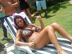 Curvy big-tittied babe posing in a bikini