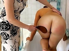 Paddled on her firm ripe ass in the bath - stinging strokes on wet buttocks