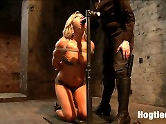 Welcome hot blonde babe Cameron Dee. Eager to please, we start with tying this bitch for you on camera into a nice tight chest harness. Bringing her down to her knees, she is made to impress by sucking a cock. We see how far down those luscious lips wrap around a dripping wet dick as the drool runs down her chest. She is made to stand with her cunt locked in place by the same cock and her torso attached to springs. Cameron is made to bounce on that cock, to ride it hard, and give a show about her eagerness to get off.Second Cameron is bound on the Y Frame, showing off her amazing figure. Oiled up, she gets treated with dripping hot wax all over her body, challenged to take the cane and pussy flogging. This cunt isn't built for pain, she is more of a pleasure model. Claire slides her fist into Cameron, inverts her on the frame, and relentlessly attacks for orgasms.Last but not least, our horny honey pot has not had nearly enough orgasms to our satisfaction. She is bound with a strict strappado on the sybian. A ball gag head harness and wrist bondage keep her at attention and the vibrating monster sybian between her legs keeps her desperately wanting more in her cum addiction. A rope is added to her neck bondage pulling her both backward and forward, locked in place. No longer able to move, a zipper is added to her torso and pulled at the height of what seems to be her most intense orgasm of the day, rounding her off as clearly well used.