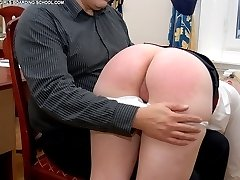 Stunning blonde schoolgirl receives a severe spanking on her bared buttocks