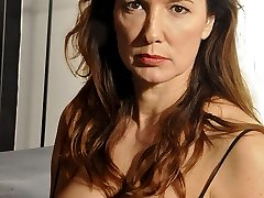 Nylon Jane dressed in gorgeous black lingerie and of course some sultry stockings on her bed