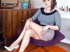 Sapphire in premium French RHT nylons and adorable lingerie poses provocatively on her chair.