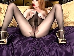 Leggy redhead Nicole, parading in sheer black nylon pantyhose with a very see through crotch!