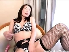 Domme toys her pussy