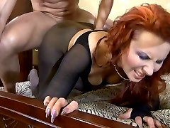Fiery babe gets her huge pantyhosed posterior oiled for a freaky nylon fuck