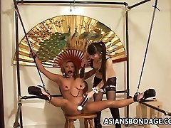 Confined Asian chick tormented by her smoking hot mistress