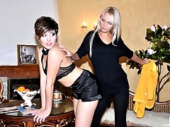 Sultry blonde pushes a brunette�s thong aside aching to taste her wet muff