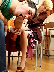 Lewd secretary in reinforced soles tights sliding her feet into guy�s mouth