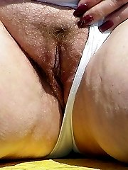 Fat older blonde exposes her pussy and ass in public