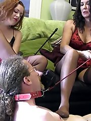 Dommes trample and smother sissy slave with their high stilettos and nylon feet, as they use him as a servant foot chair