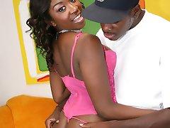 Black babe displays her pierced hard nips