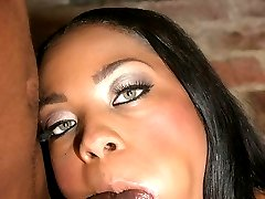 Sultry ebony with a sweet face Dream stripping off her clothes and stuffing her mouth with a black cock