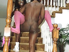 Sultry ebony in pink fishnets gets slammed on the stairs