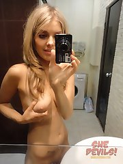 Stunning blonde girl friend does some mirror shots