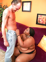 Horny ebony bbw Chocolat Hottie showing off her brown gazongas and spreading her fat cooze to get dicked