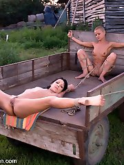 Sabrina works at a well in an open field on a scorching summer day.  Her master,  Steve Holmes, arrives with one of his slave girls, CJ, and is disappointed with Sabrina's productivity.  She is punished and put to better use by sexually servicing him.  In tight bondage, she sucks cock and gets fucked in the ass!