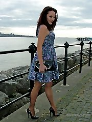 Carrie takes in a stunning view, so why don't you of her? She wearing her silky nylons and black stiletto heels just for you