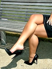 A tight black dress and matching heels cover this babe