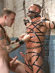 Coby Mitchell sways in ropes, hung from the racks in a meat locker. His tormentor, Christian Wilde arrives in a latex apron to inspect the suspended man-meat. Christian crops Coby up and down before stretching Coby's balls with a heavy cluster of weights. He attaches a clover clamp chain onto Coby's nipples and adds more weights to it. Coby can barely handle the pressure on his balls and nipples as Cristian resumes cropping. Christian brings Coby back to earth and has the stud worship his massive cock. He brings out the flogger and warms up Coby's body. Rock hard from Coby's blowjob and his screams, Christian plunges deep inside his captive. Christian decides to give his meat a good cleaning, so he chains Coby to the wall and fits more clamps all over his torso and thighs before spraying him down. The harsh, freezing water from the hose knocks the clamps from Coby. Now that Coby's all clean outside, Christian inserts an enema hose inside Coby before fucking him deep again and covering his ass in hot cum. Coby eats a handful of his own cum and gets turned around to have his balls milked. He blows a thick load right before Christian resumes the torment, slapping his body all over and spraying him down again.
