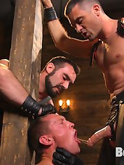 Training day is upon us here at Bound Gods and not only do we have a new muscle sub, Pierce Hartman, but house dom Jaxton Wheeler has his protege, Lance Hart by his side to help break in the new boy. After educating their new sub on proper etiquette, Jaxton uses Pierce's mouth to show Mr. Hart the oral portion of their training.  Lance jams his hard cock down his slave's mouth, looking down on the boy's hungry eyes as he swallows it to the hilt.  Next begins the ass training; sliding up and down on a huge dragon cock, Pierce must endure a brutal flogging from all directions as Mr. Hart learns the way of the whip.  The muscled slave licks the juices off the Bad Dragon dildo before he's blindfolded, bound in rope as he's mounted on top of Jaxton's hard cock.  The dragon dick was only the beginning for Pierce as Lance slides in from behind, DP'ing the bound hunk as he moans in ecstasy.  Finally Pierce worships his new master's foot before blowing his load all over it and licking up every drop.