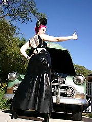 busty redhead slips off rubber in vintage car