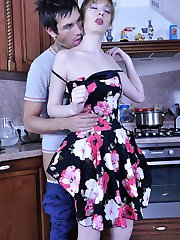 Wanton housewife encased in fine grey tights nailed on the kitchen table