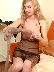 Cutie fitting on her classy pantyhose and short skirt in front of mirror