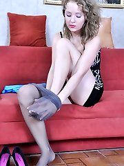 Dolled-up curly-head slowly changes out of her black sheer-to-mid-body stocking