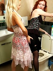 Lesbo blonde goes south on letting her black-stockinged friend use bathroom