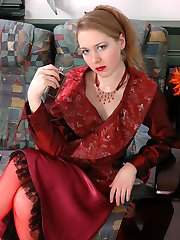 Dressed to kill hottie teasing with her red lace top nylons and lacy undies
