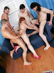 This chubby redhead mom wants to get gangbanged and four younger studs are ready to help