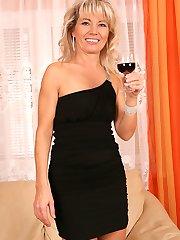 Older babe Janet Darling enjoys wine while fingering herself.