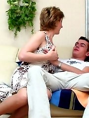 Sex-addicted mature chick giving well-hung guy a thrill right on the sofa