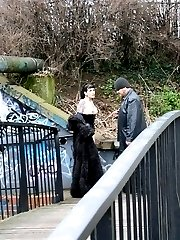 Hot gothic slut treated as a dog in a public bridge