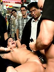Karmen Karma enjoys the attention of gawkers and filthy minded old men in a psychotically rainbow colored souvenir and candy shop.  Spanked, used and manhandled as she rubs her hot little ass on the hard cocks that surround her.She gets tied up and finger banged by strangers while they take snapshots of their colorful San Francisco vacation.  They fuck her pussy with candy and lollipops and stuff her mouth with dicks. Finally she gets fucked for all to see by huge hard cocks. Stuffing her mouth with candy to sweeten the hot loads they spray on her.