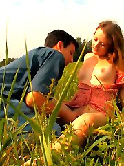 In the field, this cute brunette can`t wait to unbutton her dress and have her tender body explored by this stud. The field is wide open and someone could see them, but that just turns them on.