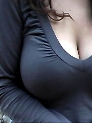 Huge matural tits exposed in a public park